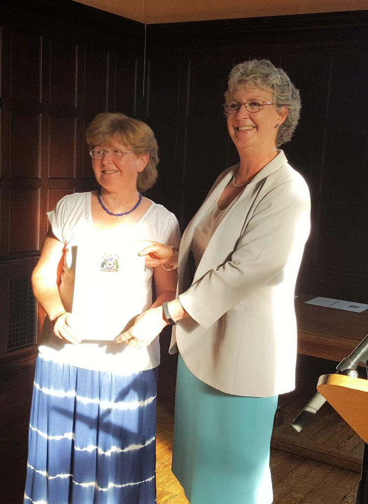 Judy Webb receiving her Certificate of Honour
