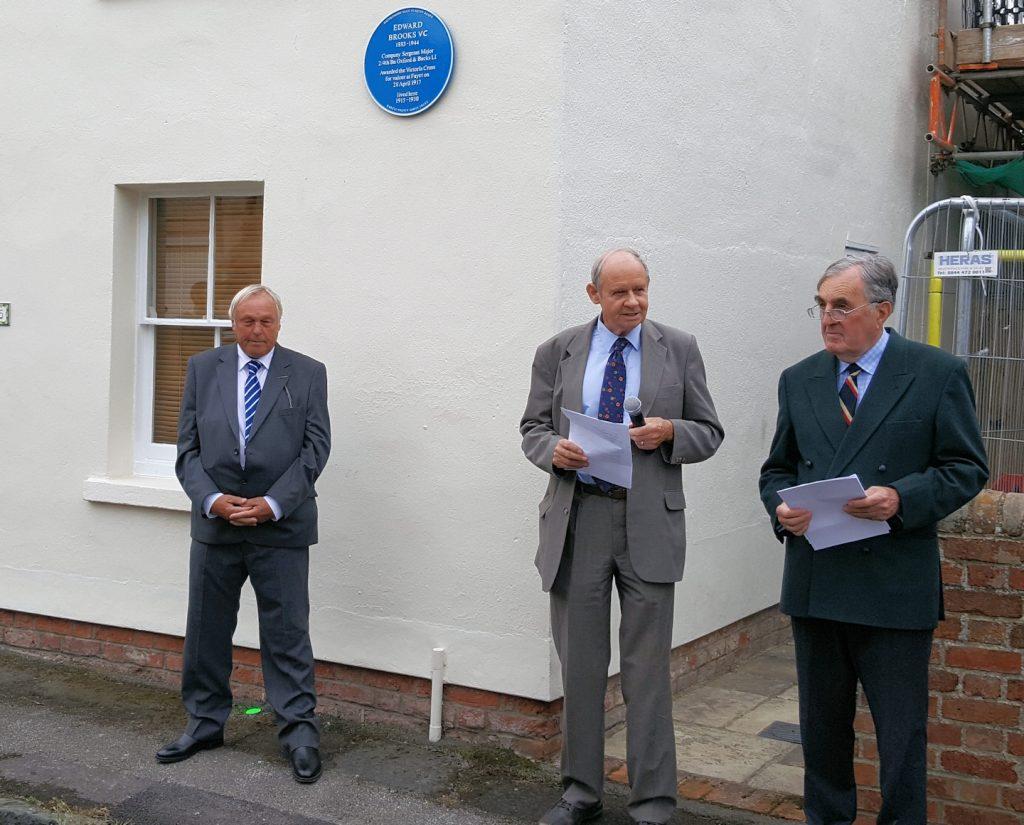 Keith Brooks (grandson), Prof. Robert Evans & Brigadier Nigel Mogg 'unveil' the plaque